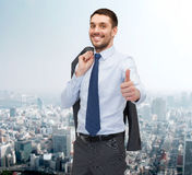 Smiling young businessman showing thumbs up Royalty Free Stock Photo