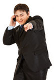 Smiling young businessman talking on mobile phone Stock Photography