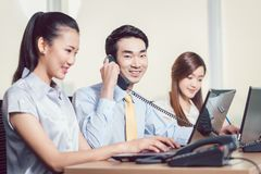 Smiling young businessman talking on telephone royalty free stock photo