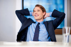 Smiling young businessman thinking something Royalty Free Stock Photo