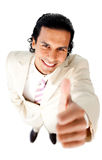 Smiling young businessman with thumb up Royalty Free Stock Images