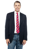 Smiling young businessperson posing casually Stock Photography