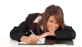 Smiling young businesswoman with clipboard Stock Photo