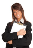 Smiling young businesswoman with clipboard Royalty Free Stock Images