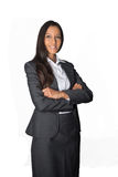 Smiling young businesswoman with folded arms Stock Photography