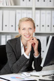 Smiling Young Businesswoman With Hands On Chin Royalty Free Stock Images