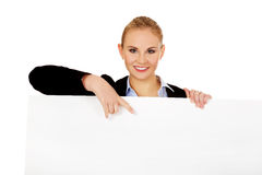 Smiling young businesswoman holding blank banner Stock Images