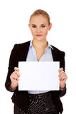Smiling young businesswoman holding blank banner Royalty Free Stock Photo