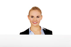 Smiling young businesswoman holding blank banner Stock Photo