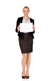 Smiling young businesswoman holding blank banner Stock Photos