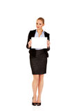 Smiling young businesswoman holding blank banner Royalty Free Stock Images