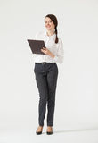 Smiling young businesswoman holding clipboard Stock Photos