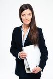 Smiling young businesswoman holding folders Royalty Free Stock Photography