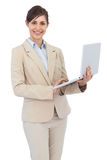 Smiling young businesswoman holding laptop Royalty Free Stock Photography