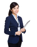 Smiling young businesswoman holding laptop Stock Photos