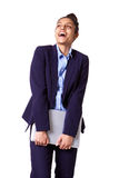 Smiling young businesswoman holding laptop and looking away Royalty Free Stock Photos