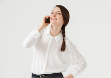 Smiling young businesswoman holding a mobile phone Stock Images