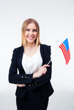 Smiling young businesswoman holding US flag Royalty Free Stock Images