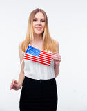Smiling young businesswoman holding US flag Stock Image