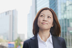 Smiling Young Businesswoman Looking Away Stock Image
