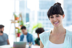 Smiling young businesswoman looking at the camera Royalty Free Stock Photo