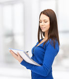 Smiling young businesswoman with notebook Royalty Free Stock Images