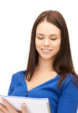 Smiling young businesswoman with notebook Royalty Free Stock Photo