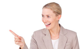Smiling young businesswoman pointing Stock Images