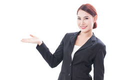 Smiling young businesswoman showing blank area for sign Royalty Free Stock Images