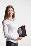 Smiling young businesswoman showing blank no-name tablet pc monitor with copyspace area for slogan or text message. business conce Royalty Free Stock Photography