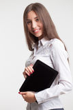Smiling young businesswoman showing blank no-name tablet pc monitor with copyspace area for slogan or text message. business conce Royalty Free Stock Photo