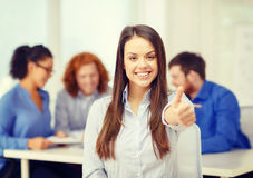 Smiling young businesswoman showing thumbs up Royalty Free Stock Images