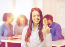 Smiling young businesswoman showing thumbs up Royalty Free Stock Photos