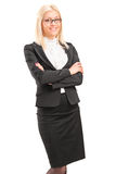 Smiling young businesswoman standing Stock Photos
