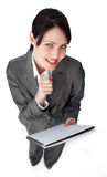 Smiling young businesswoman taking notes. Against a white bakground Royalty Free Stock Image