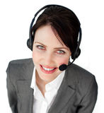 Smiling young businesswoman talking on a headset Stock Photo