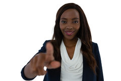 Smiling young businesswoman touching imaginary screen Royalty Free Stock Photography