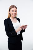 Smiling young businesswoman using her smartphone Stock Photography