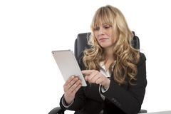 Smiling young businesswoman using her tablet Stock Image