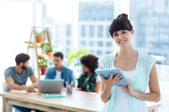 Smiling young businesswoman using tablet Royalty Free Stock Image