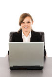 Smiling young businesswoman working at her computer Royalty Free Stock Image