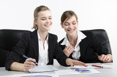 Smiling young businesswomen. Two smiling young businesswomen in office Stock Photos