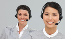 Smiling young businesswomen with headset on Stock Photography