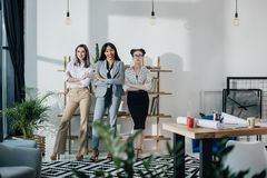 Smiling young businesswomen standing together and looking at camera Royalty Free Stock Image