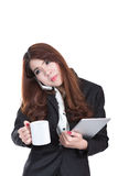 Smiling young busy business woman , concept multi task with phone , cup of coffee and computer tablet Stock Image