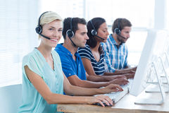 Smiling young call centre worker Stock Images