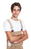 Smiling young carpenter with crossed arms Royalty Free Stock Image