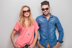 Smiling young casual couple looking at the camera Stock Photo