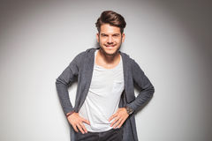 Smiling young casual man with hands on waist Royalty Free Stock Photography