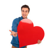 Smiling young casual man inviting you to love him Royalty Free Stock Images